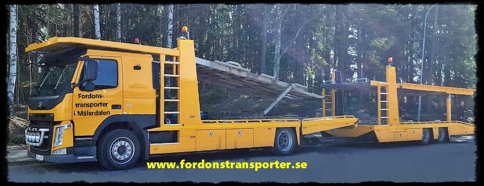 Transportera traktor på bilsläp